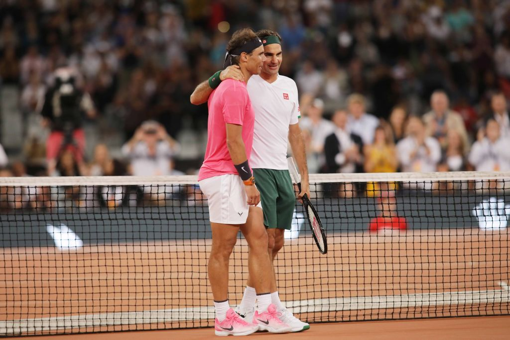 Roger Federer (R) of Switzerland and Rafael Nadal of Spain play a charity tennis match