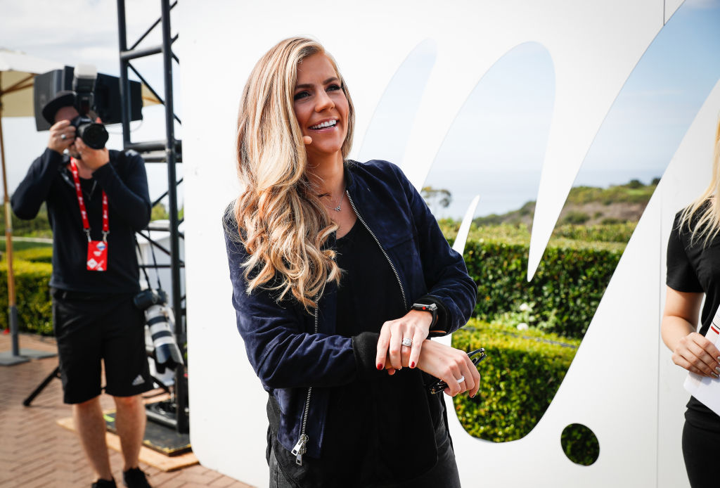 ESPN's NFL Countdown host Samantha Ponder smiling at an outdoor event.