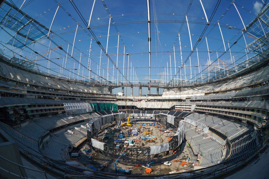 The giant Oculus 2-sided video board is being assembled inside on the floor of SoFi Stadium