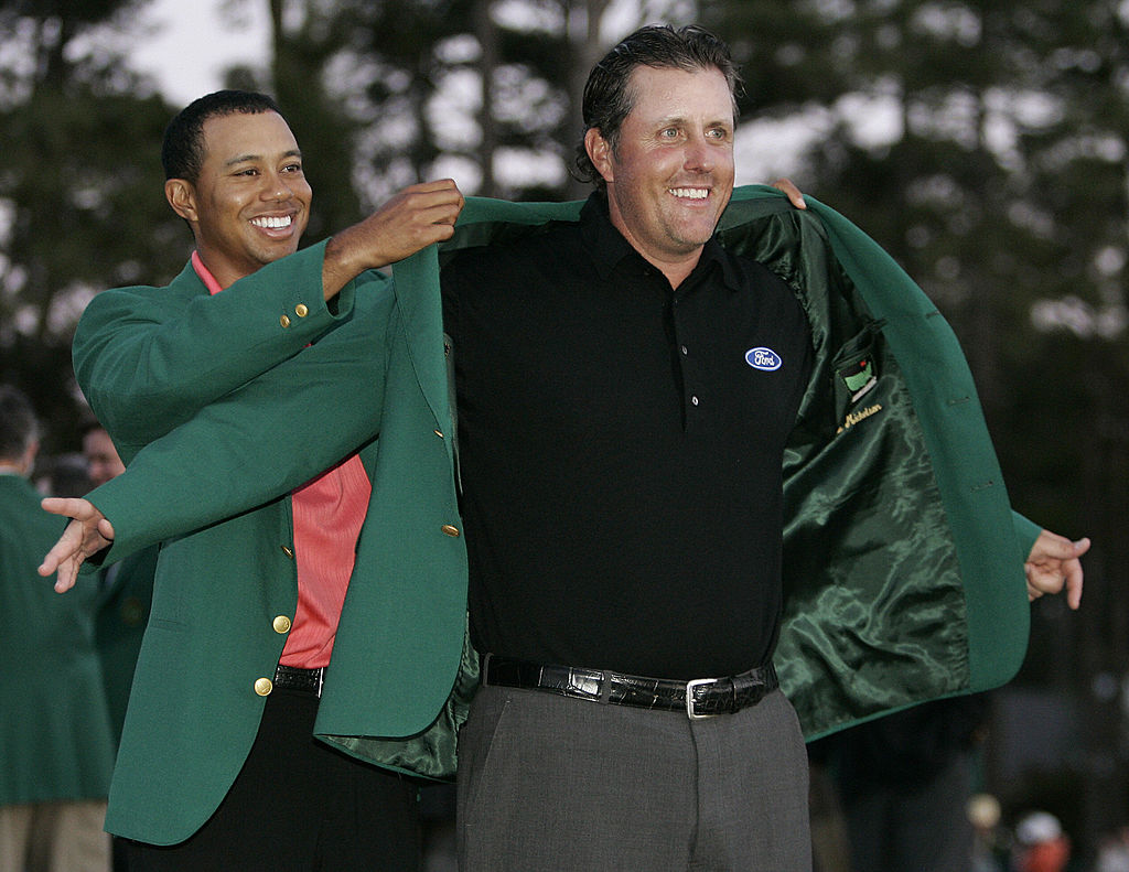Phil Mickelson and Tiger Woods wearing Masters green jackets
