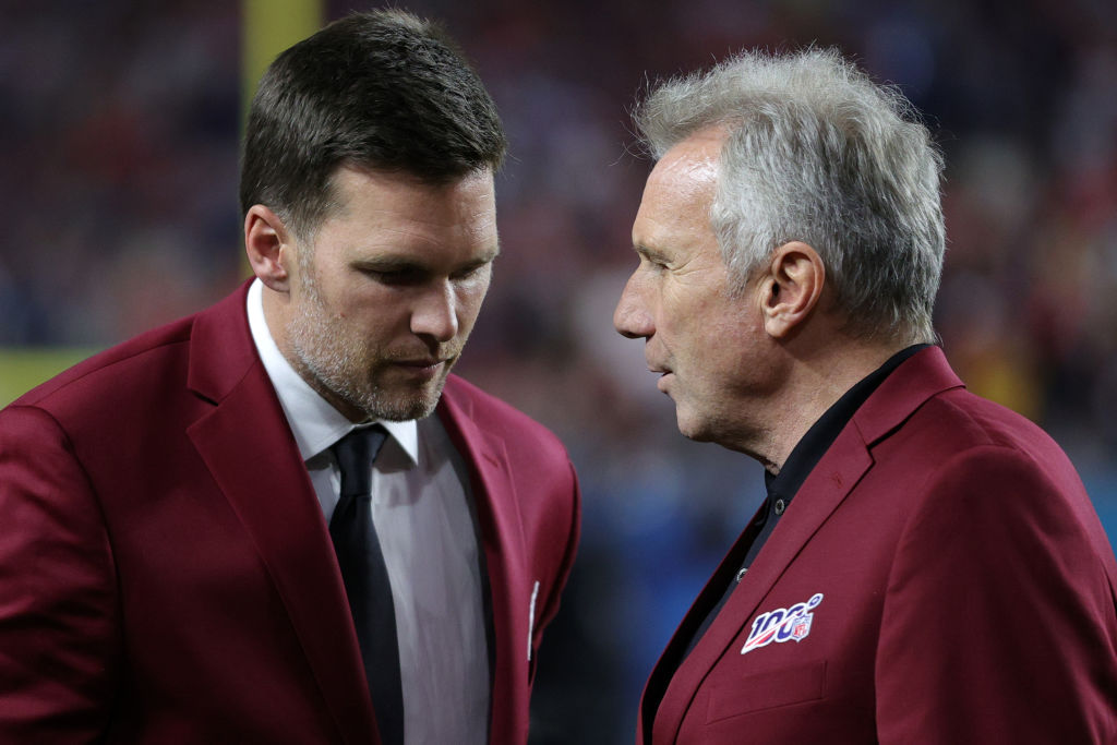 Tom Brady of the New England Patriots talks with Hall of Famer Joe Montana prior to Super Bowl LIV