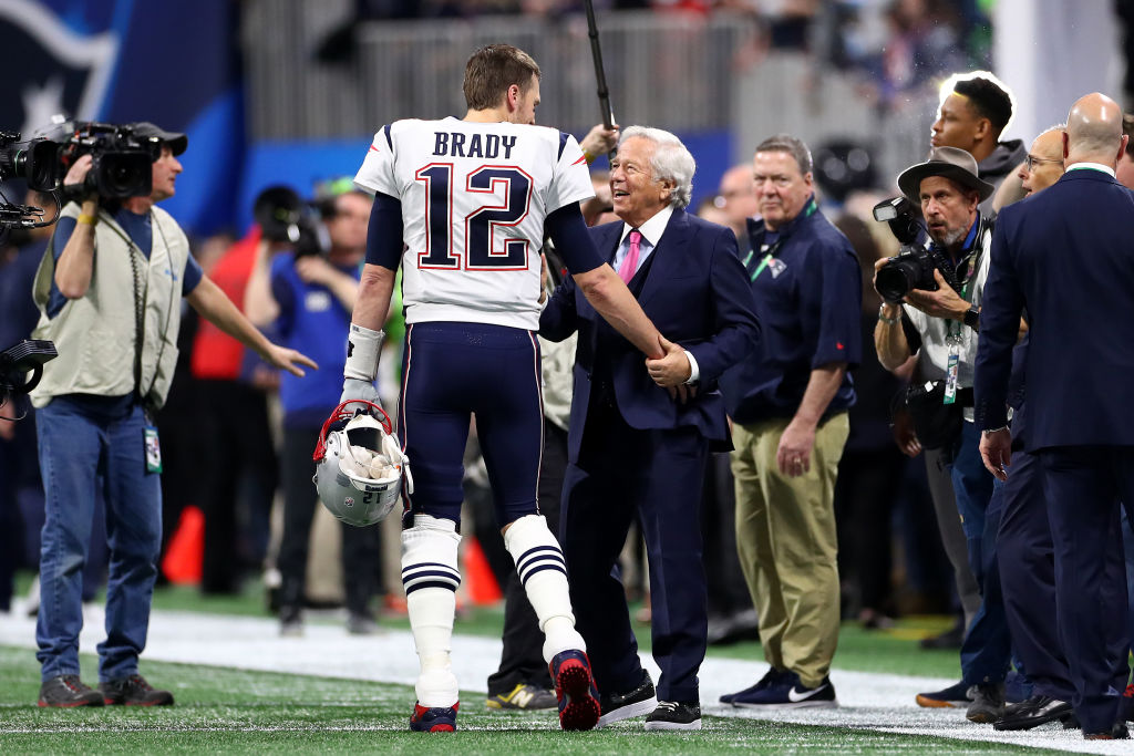 Tom Brady of the New England Patriots speaks with owner Robert Kraft prior to Super Bowl LIII