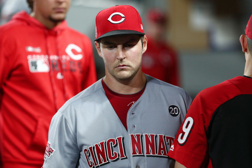 Trevor Bauer of the Cincinnati Reds reacts in the dugout