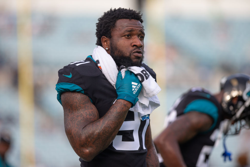 Yannick Ngakoue stands on the sideline during a Jaguars game