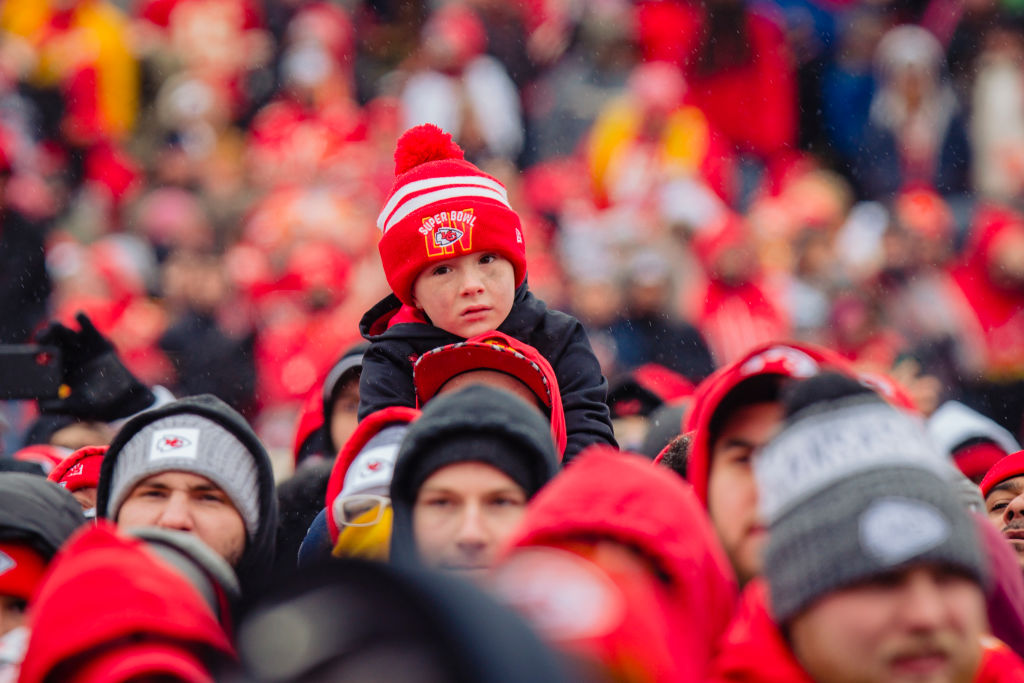 A young fan looks on during the Kansas City Chiefs Victory Parade on February 5, 2020
