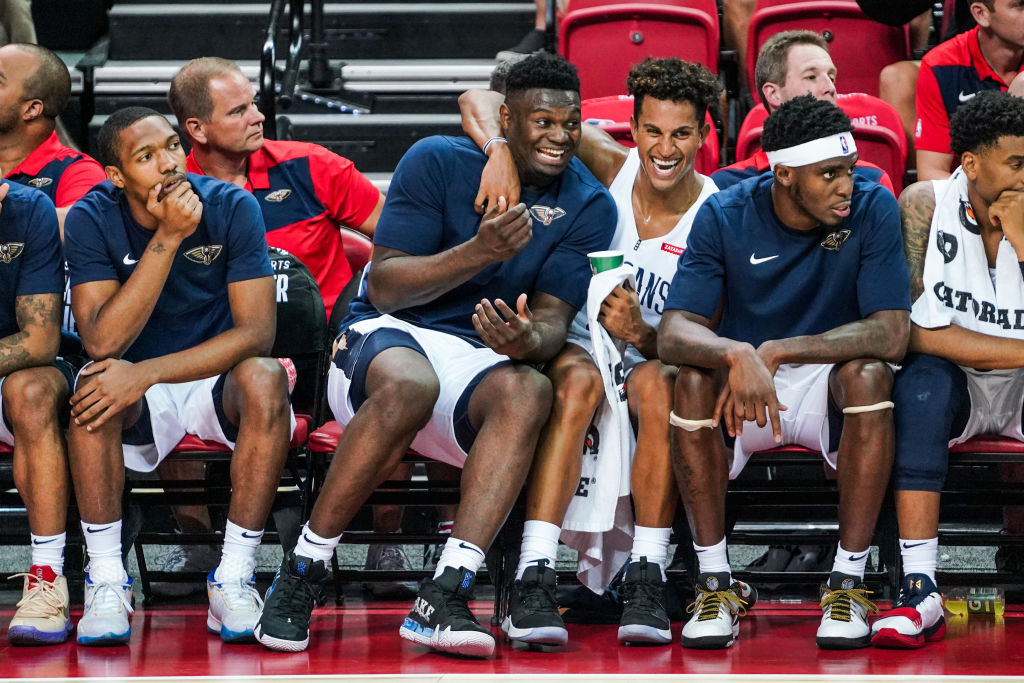 Zion Williamson (L) and Frank Jackson (R) of the New Orleans Pelicans laugh together on the bench