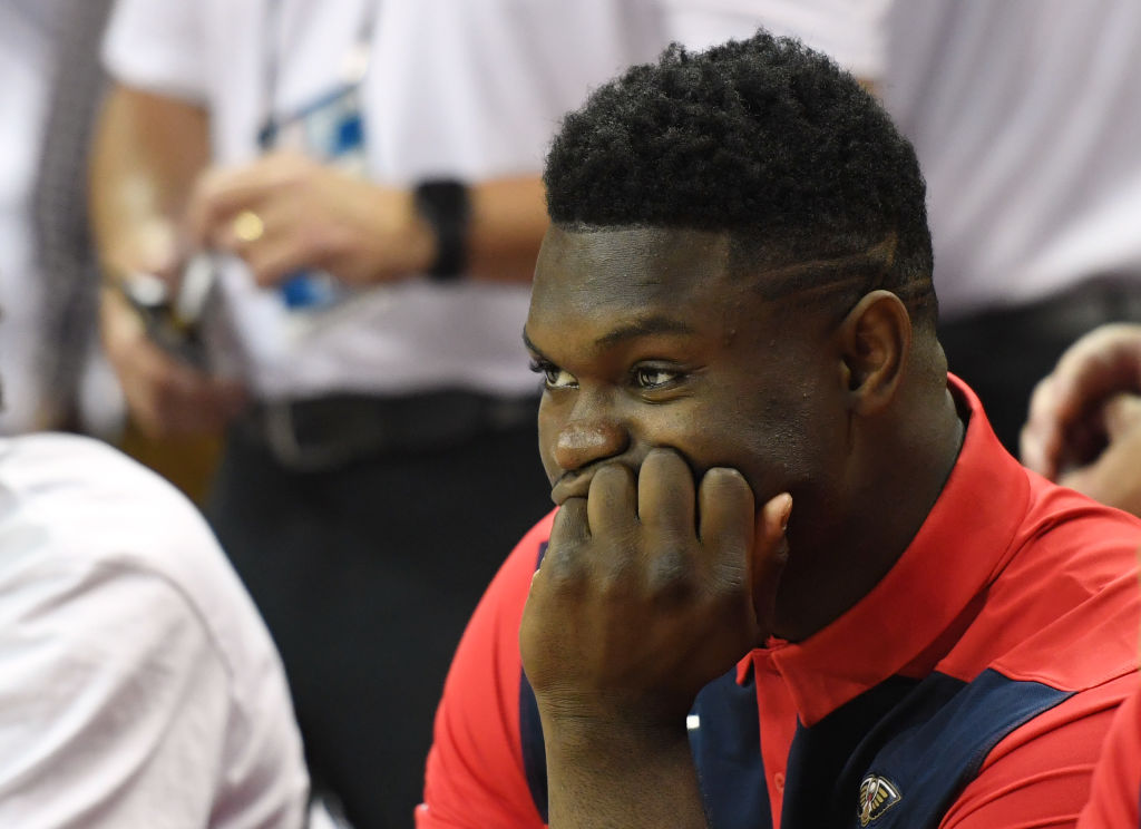 Zion Williamson sitting on the bench during a Pelicans game