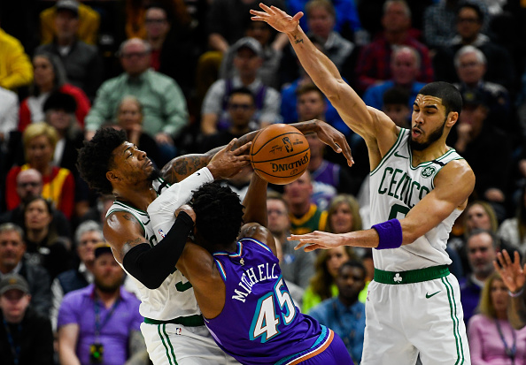 Celtics players Marcus Smart and Jayson Tatum defending Utah Jazz Donavan Mitchell