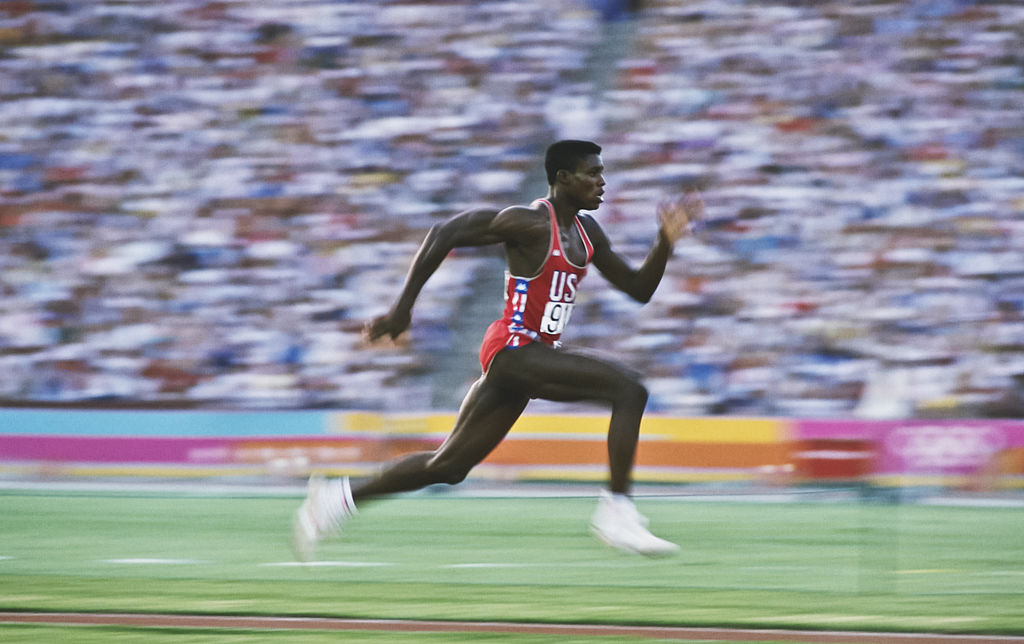 Carl Lewis of the USA accelerates down the runway of the long jump during the 1984 Summer Olympics in Los Angeles