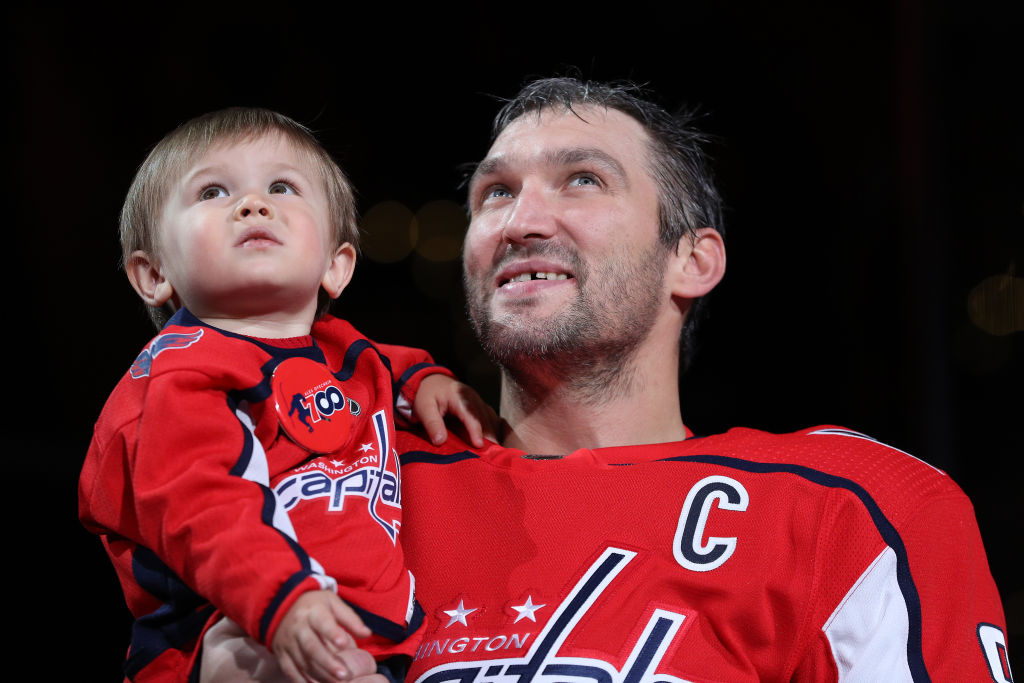 Alex Ovechkin of the Washington Capitals holds his son, Sergei, as he acknowledges the crowd