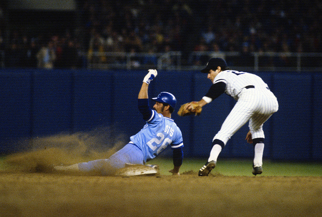 Shortstop Bucky Dent of the Yankees puts the tag on Amos Otis of the Royals in 1980
