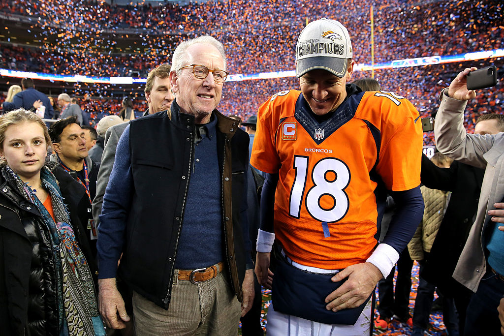 Archie Manning celebrates with Peyton Manning after the Denver Broncos won the AFC Championship Game.