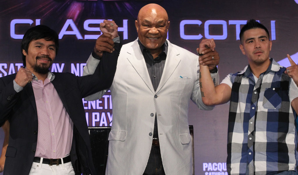 Boxers Manny Pacquiao, George Foreman, and Brandon Rios attend a 2013 conference in Macau, China