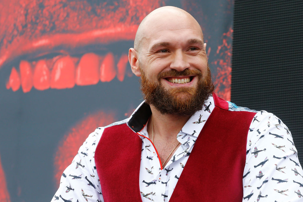 Tyson Fury smiling at a pre-fight media event