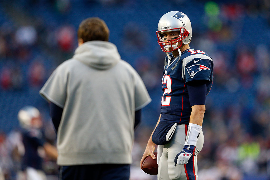 Tom Brady of the New England Patriots looks at head coach Bill Belichick.