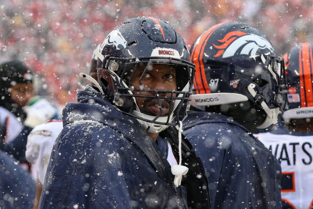 Denver Broncos outside linebacker Von Miller tries to stay warm on the bench