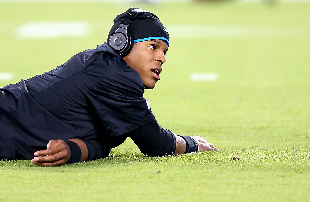 Cam Newton of the Carolina Panthers warms up in 2014