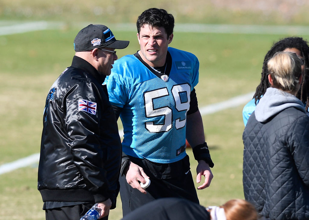 Carolina Panthers owner David Tepper talks with middle linebacker Luke Kuechly during practice in 2019