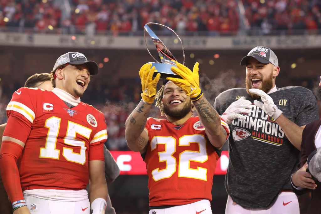 Chiefs quarterback Patrick Mahomes, safety Tyrann Mathieu, and tight end Travis Kelce with the Lamar Hunt Trophy after the AFC Championship