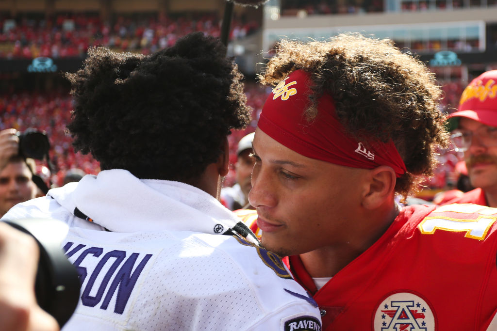 Kansas City Chiefs quarterback Patrick Mahomes and Baltimore Ravens quarterback Lamar Jackson meet midfield