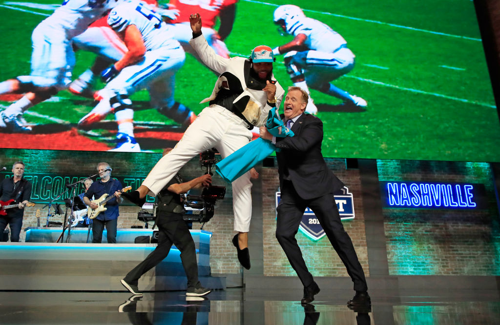 Christian Wilkins of Clemson celebrates with NFL Commissioner Roger Goodell after being chosen by the Dolphins during the 2019 NFL Draft