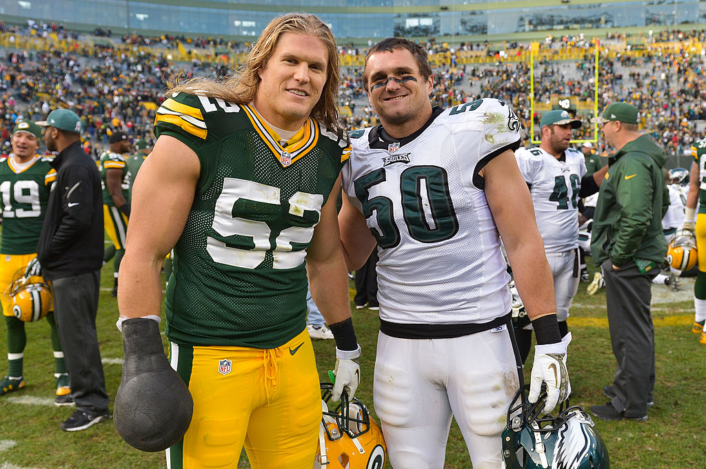 Clay and Casey Matthews pose after playing against each other in a game