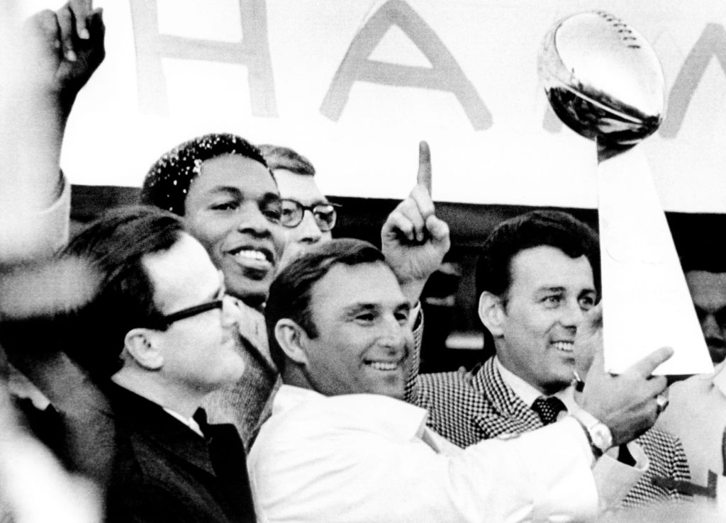 Head coach Hank Stram of the Kansas City Chiefs holds the Super Bowl Trophy as owner Lamar Hunt (L), Otis Taylor, and Len Dawson (R) win Super Bowl IV in 1970