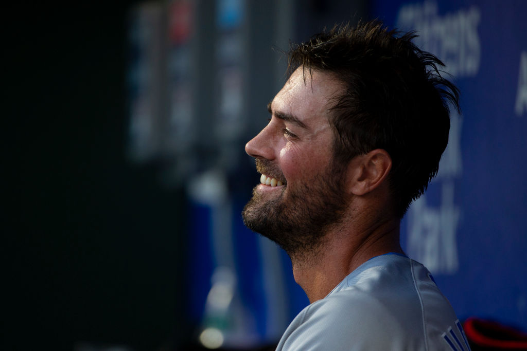 Cole Hamels looks on from the dugout