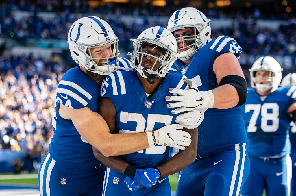 Jack Doyle, Marlon Mack, and Quenton Nelson, who play for the Indianapolis Colts, celebrate.