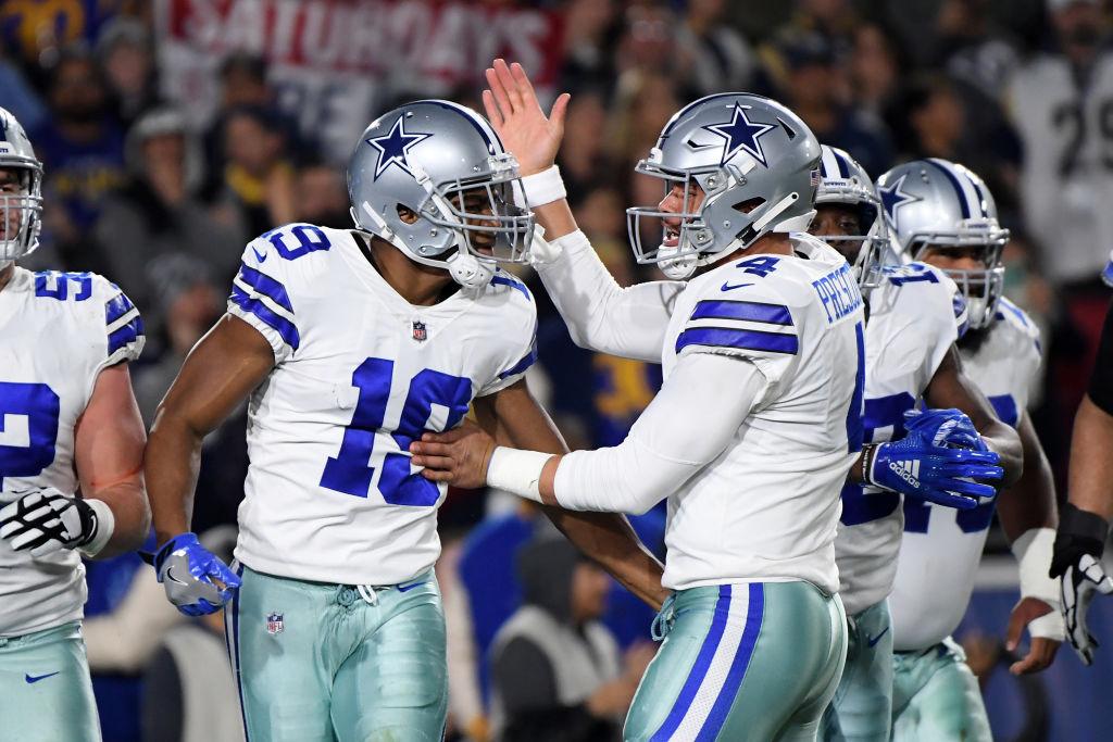 Amari Cooper of the Dallas Cowboys celebrates a 29-yard touchdown pass from Dak Prescott