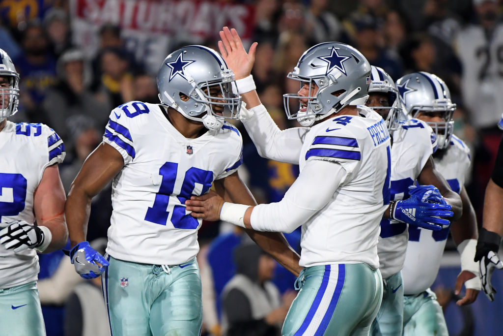 Amari Cooper of the Dallas Cowboys celebrates a 29-yard touchdown pass from Dak Prescott