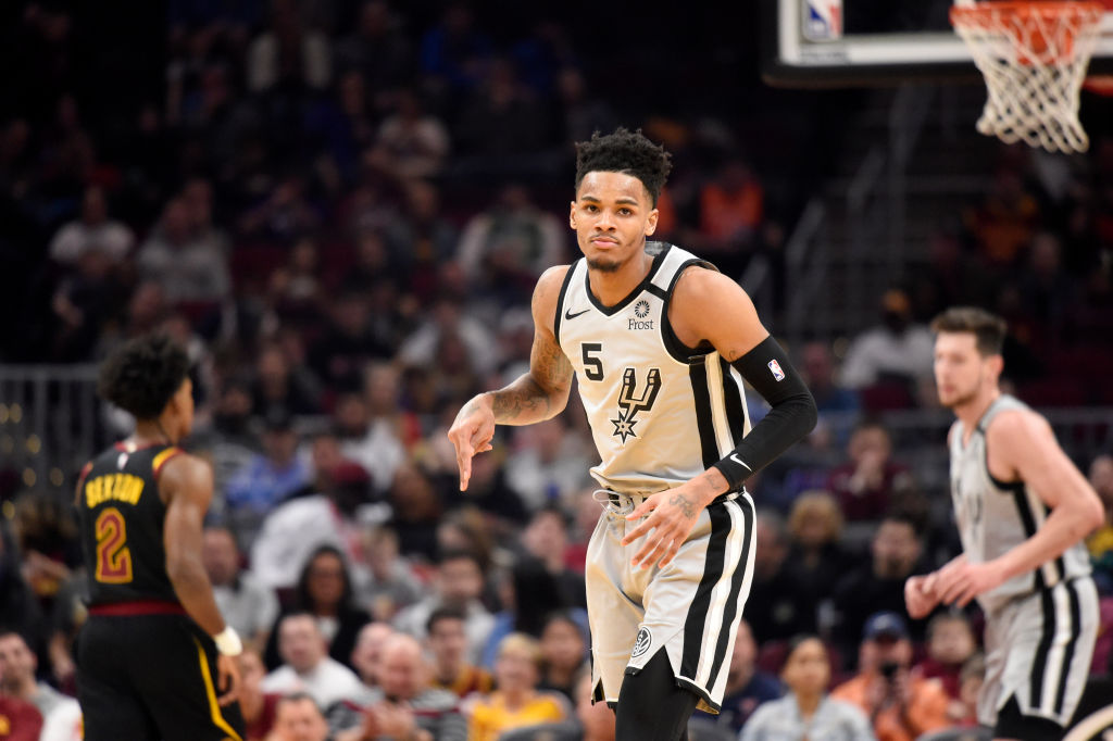 Dejounte Murray celebrates after making a shot