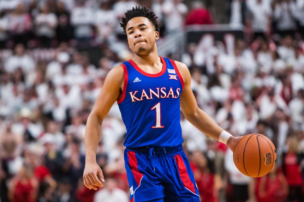 Devon Dotson dribbling the ball up the court for Kansas