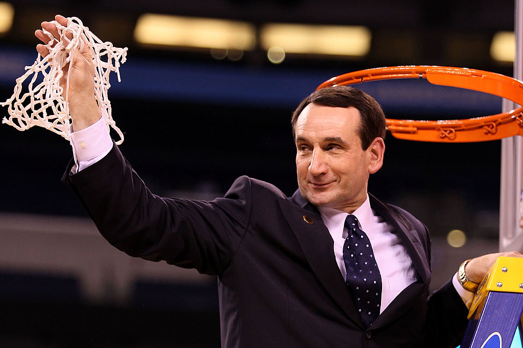 Mike Krzyzewski cutting down the net after a Duke game