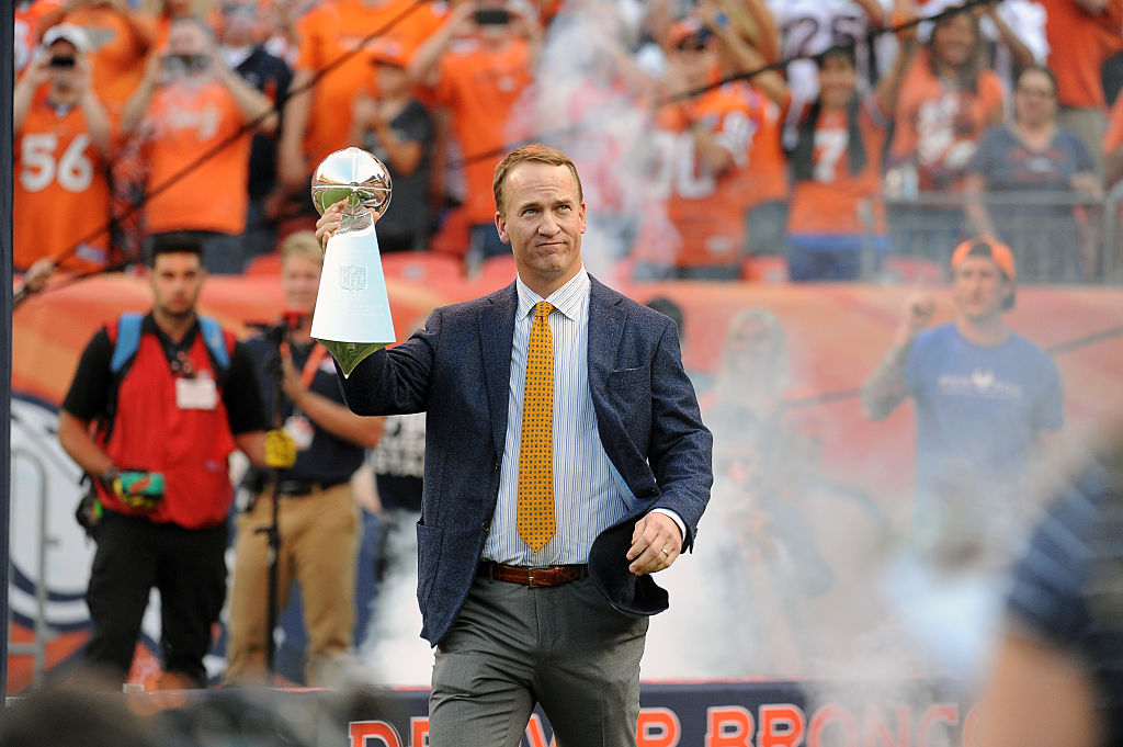 Former Denver Broncos quarterback Peyton Manning with a Super Bowl trophy