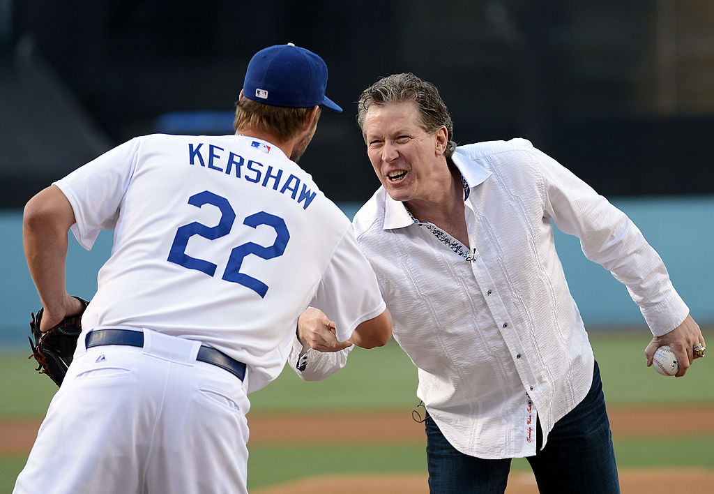 Former Los Angeles Dodgers pitcher Orel Hershiser gets a handshake from Clayton Kershaw