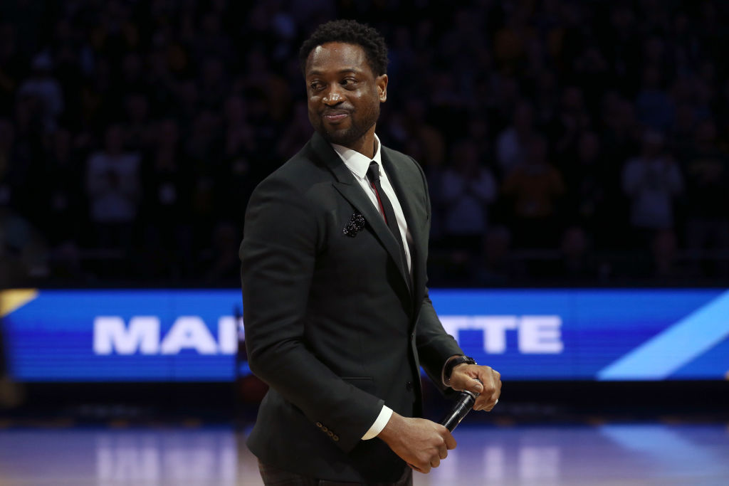Former Marquette Golden Eagles player Dwyane Wade speaks to a crowd at Marquette