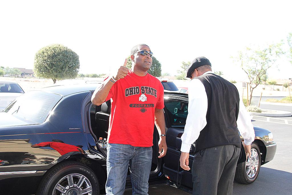 Former NFL star Cris Carter arrives at a Papa John's in 2010