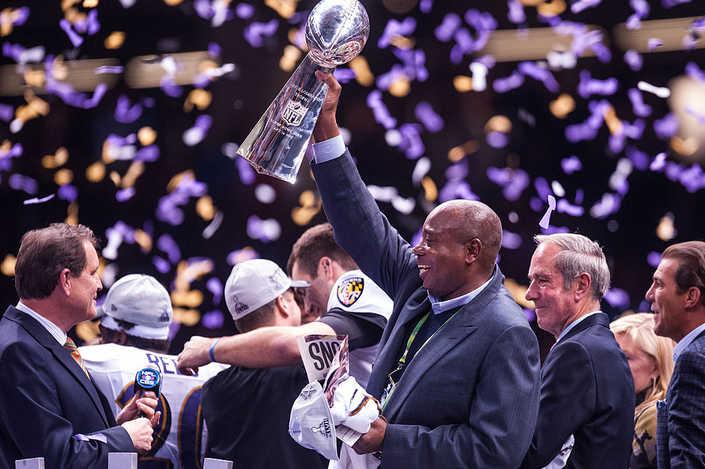 General manger Ozzie Newsome Jr. of the Baltimore Ravens holds the Vince Lombardi Trophy after Super Bowl XLVII
