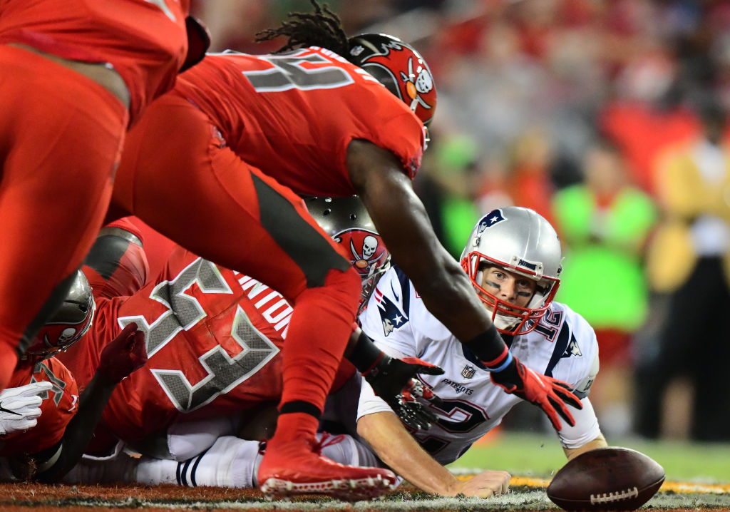 Vegas oddsmakers are offering plus odds for Tom Brady's Buccaneers to win more games than the Patriots in 2020. Does it sound like a good bet?