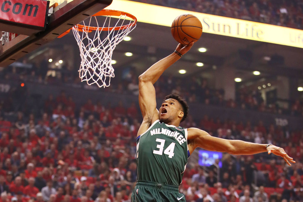 Giannis Antetokounmpo going up for a slam dunk