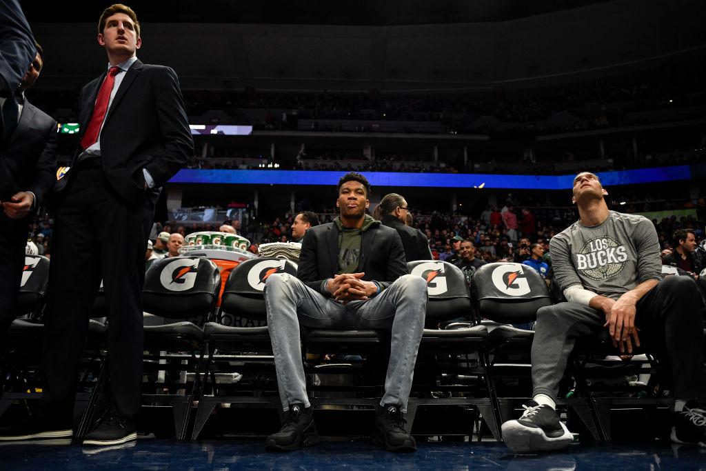 Giannis Antetokounmpo of the Milwaukee Bucks wears street clothes before a game