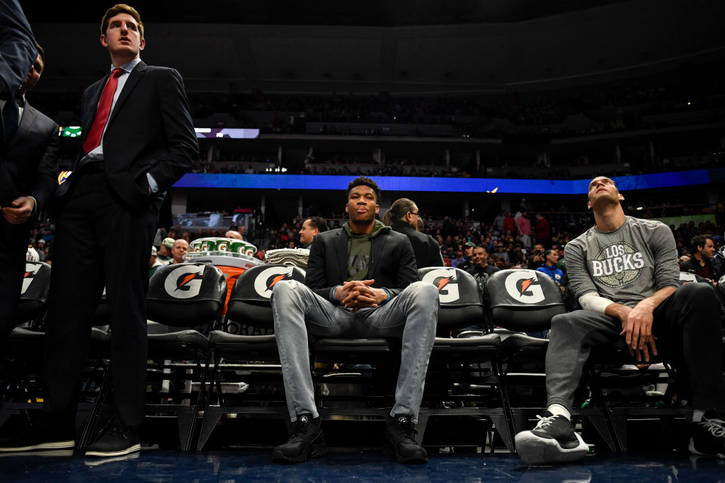 Giannis Antetokounmpo of the Milwaukee Bucks wears street clothes before a game