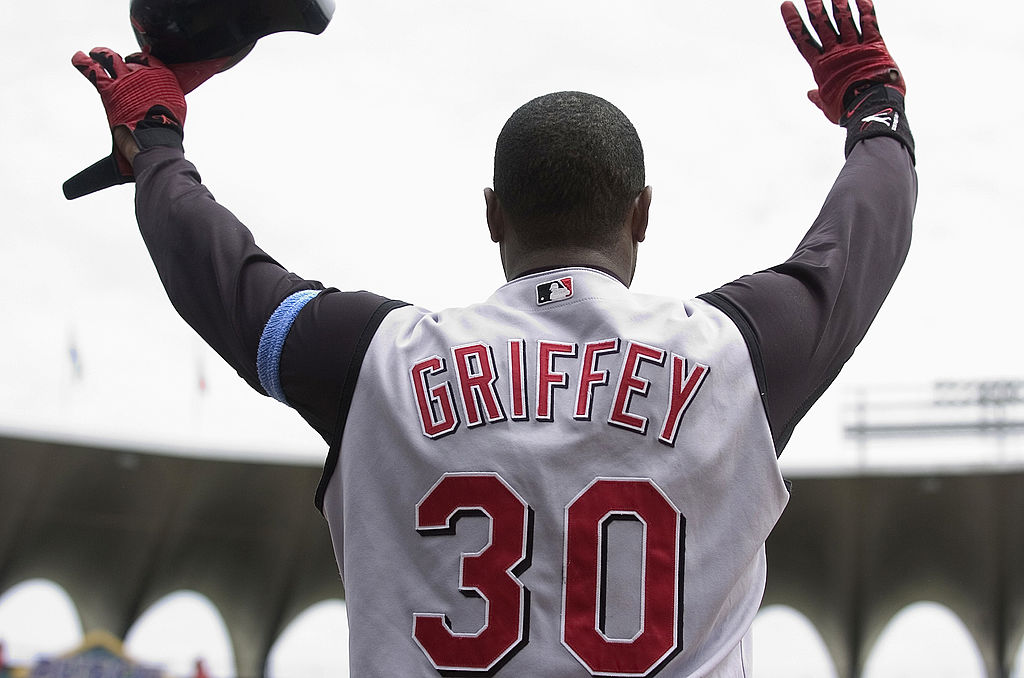 Ken Griffey Jr. celebrates as a Cincinnati Red after hitting his 500th career home run.