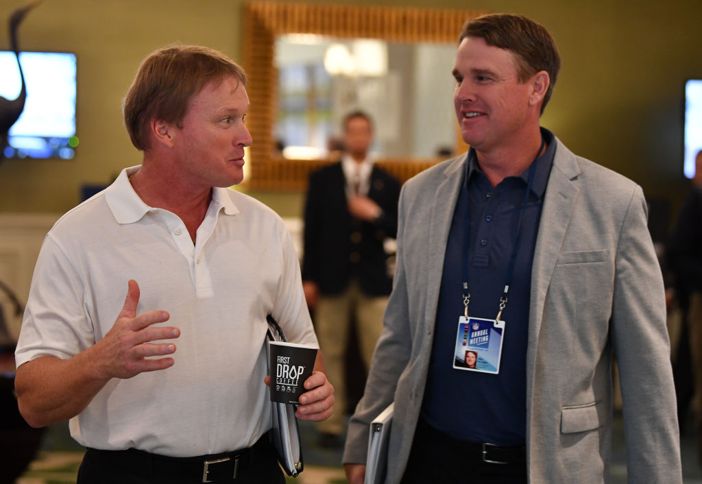 Jay and Jon Gruden walk down a hallway and talk
