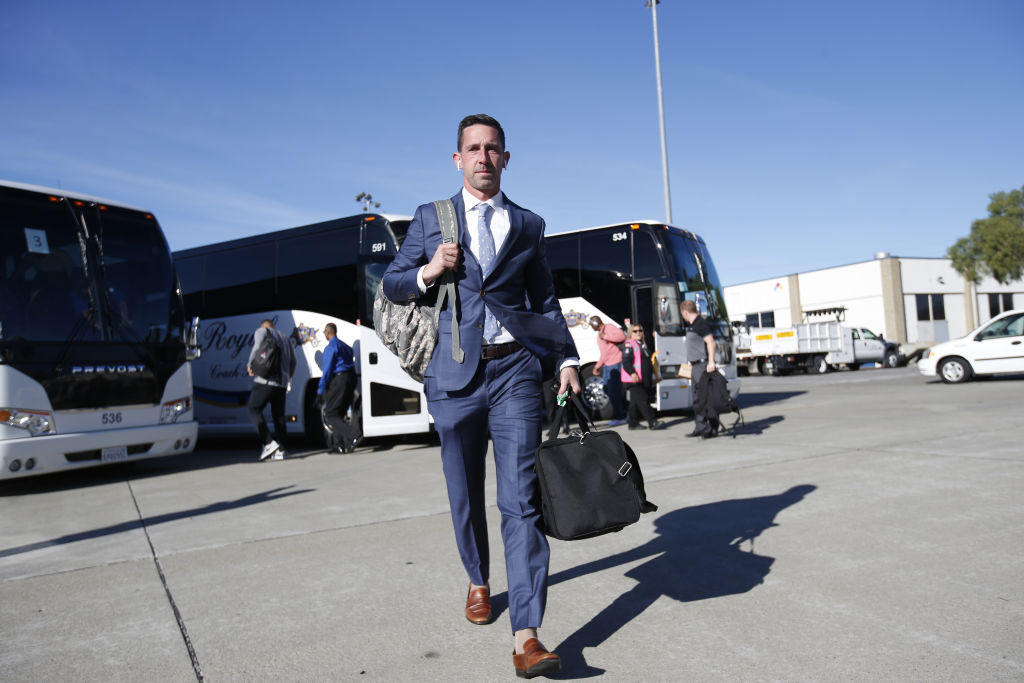 Head Coach Kyle Shanahan of the San Francisco 49ers gets ready to board a plane