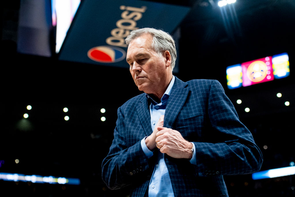 Head coach Mike D'Antoni of the Houston Rockets walks off the court after playing the Denver Nuggets