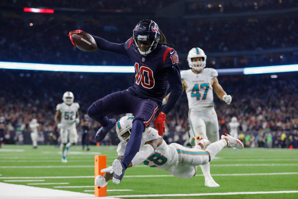 DeAndre Hopkins scores a touchdown for the Houston Texans against the Miami Dolphins.