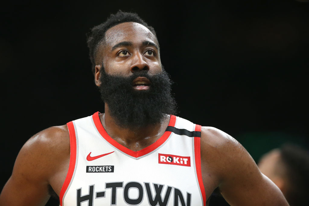 James Harden of the Houston Rockets looks on during a timeout