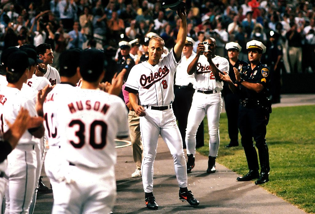 Infielder Cal Ripken Jr. of the Baltimore Orioles tips his cap to the fans after breaking Lou Gherig's record of 2,130 consecutive games played on September 6, 1995